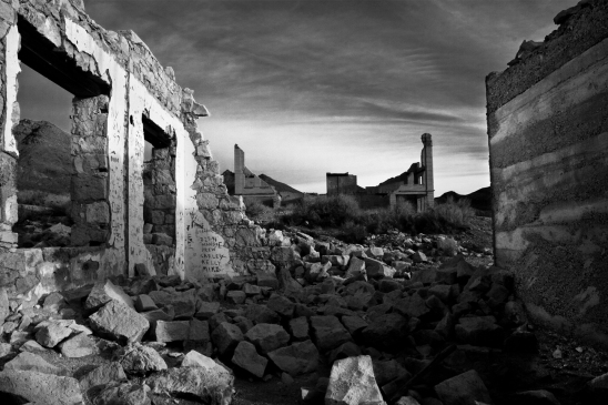 Just to the east of Death Valley, Rhyolite, Nevada was a bustling town of near 5,000 residents in the early 1900's. With the depletion of ore, the population dwindled to 0 within a decade. Testament to the lunacy of Boom bust economies.
