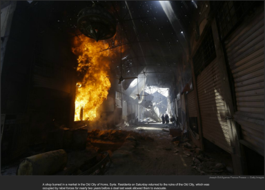 nytl_homs_shop_fire