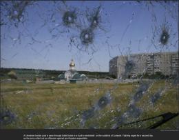 nytl_bullet_hole_glass